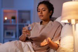 Woman thinking about taking sleep pills for sleep apnea in Melbourne