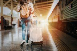 Woman with suitcase, traveling with sleep apnea in Boca Raton