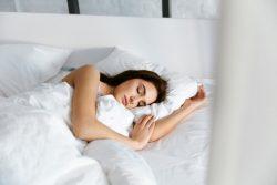 Woman sleeping comfortably under weighted blanket in Vero Beach