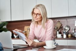 Woman learning about insurance coverage for sleep apnea treatment in Melbourne